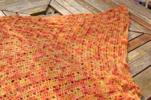 Orange BFL laceweight shawl.